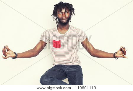 young handsome afro american guy relaxing in goofy lotos isolated on white background