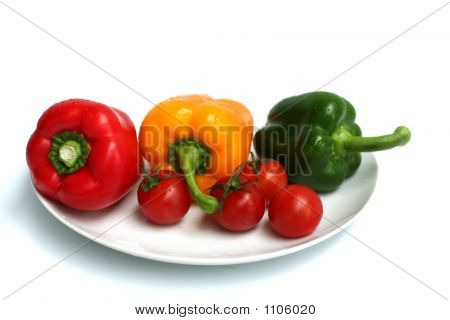 Three Peppers And Some Tomatoes