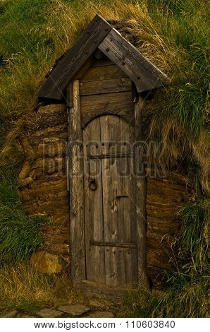 Old wooden door, a detail from reconstructed house of famous viking Erik the Red at Eirikstadir
