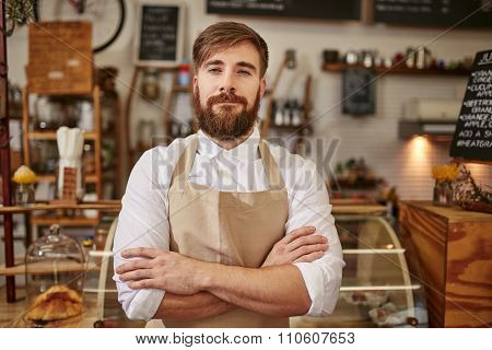Portrait Of Confident Cafe Owner