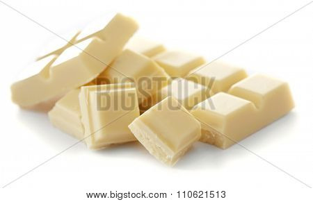 White chocolate pieces isolated on white background