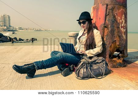 Young Woman Working With Pc Outdoor - Lonely Girl Writing Using Laptop Wifi Connected -