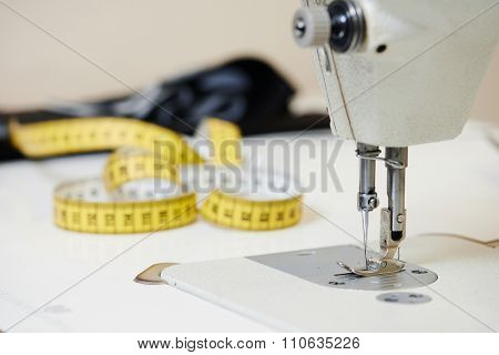 tailoring equipment. sewing machine with measure tape  poster