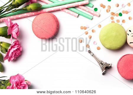 Macarons, Flowers And Souvenir Eiffel Tower On The White Background