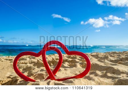 Two Hearts On The Sandy Beach