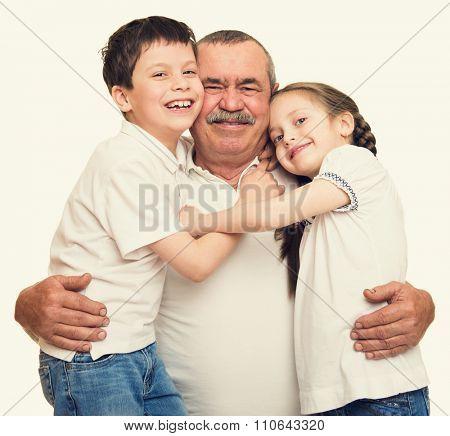 Grandfather and grandchildren portrait studio shoot