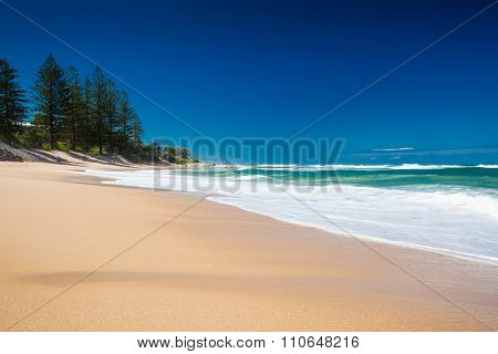 Deserted section of Dicky Beach on a sunny day, Caloundra, Queensland, Australia
