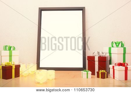 Blank Picture Frame  With Gift Boxes And Glowing Candlesticks On Wooden Floor At White Background, M
