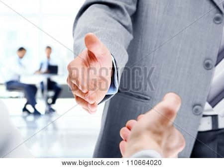 The photo shows two businessman shaking hands