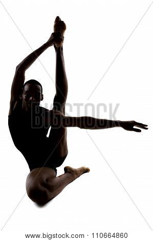 Silhouette of a Flexible Male Dancer