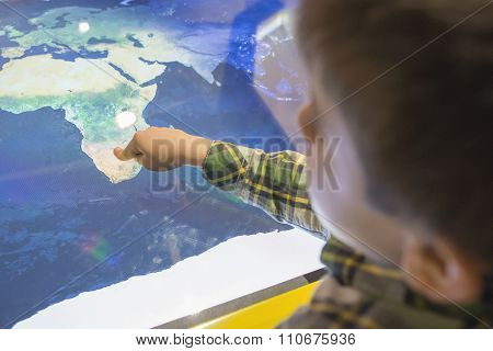 Child Pointing Africa On A Map