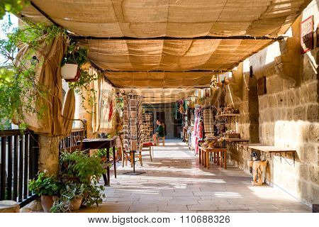 NICOSIA CYPRUS - AUGUST 10 2015: Buyuk Han (The Great Inn) Medieval caravanserai that turned into touristic center with an antique souvenir shops craft workshops and cafes in Nicosia Cyprus on August 102015