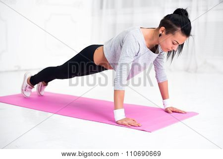 teenage girl doing push ups warming up working at home fitness, sport, training, diet and lifestyle