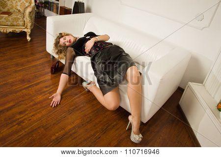 Lifeless Woman Lying On Sofa
