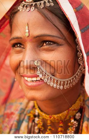 Portrait of Traditional Indian woman in sari costume covered her head with veil, India