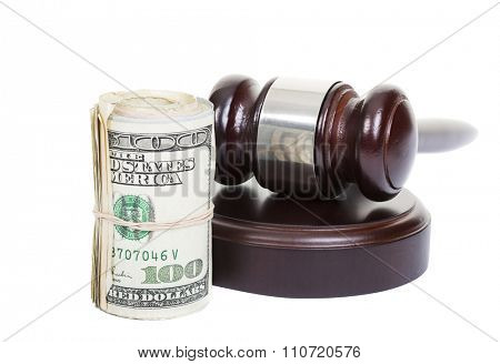 Law gavel with a roll of American money on white background.