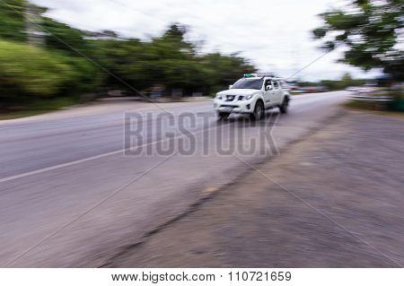 White Car Speeding In Road