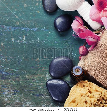 Spa background (pink orchid, herbal compress stamps, sea salt, towel and massage stones)