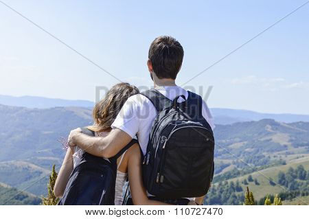 Couple Of Hikers With Backpacks At Viewpoint
