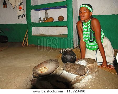 Zulu Woman Cooking Maize Meal At Tribal House,lesedi Village, South Africa
