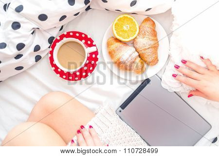 Woman On Bed With Tablet, Breakfast And Coffee, Relaxing On A Sunday Morning