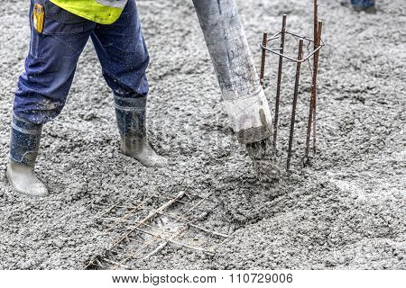 Detail Of Construction Site - Worker Pouring Cement And Concrete With Pump Tube