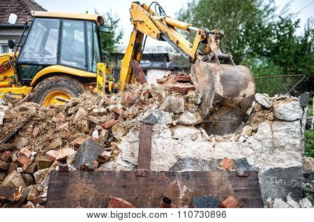 industrial machinery working with debris and dust loading a dumper truck poster