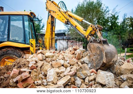 Industrial Hydraulic Excavator On Construction And Demolition Site, Recycling Construction Waste