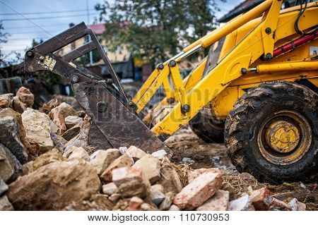 Bulldozer Loading Demolition Debris And Concrete Waste For Recycling