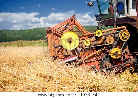 process of harvesting with combine gathering mature grain crops from field. poster
