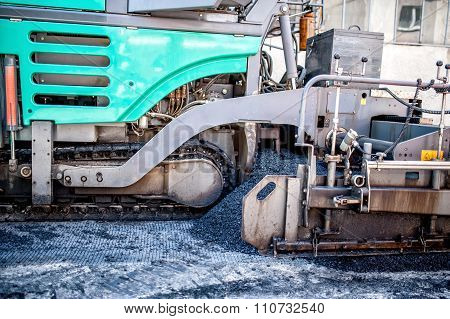 Asphalt Paver Machine During Road Construction And Repairing Works