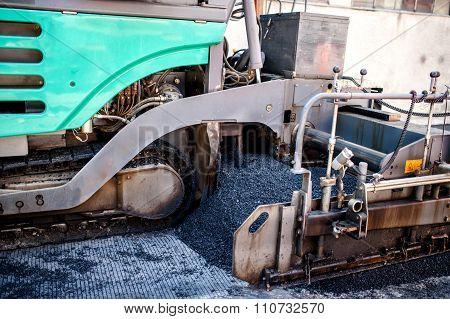 Industrial Pavement Truck Or Machine Laying Fresh Bitumen And Asphalt