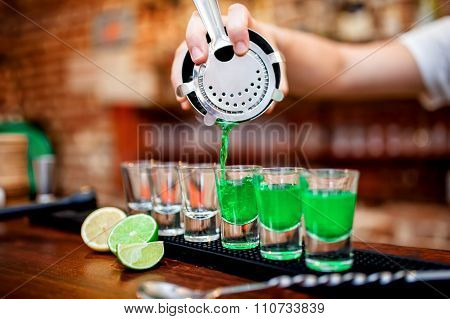 Close-up Of Bartender Hand Pouring Alcoholic Drink In Restaurant
