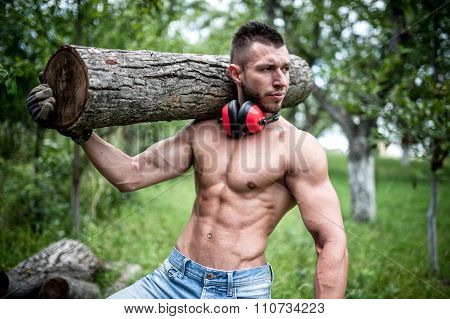 Handsome Male Model Moving Logs, Cutting Firewood And Posing