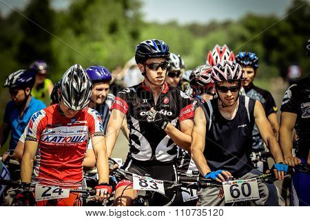group of athletes riders preparing for  start race starting line