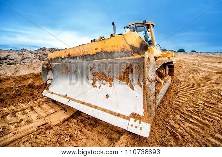Close-up Of Bulldozer Blade, Industrial Machines Working In Sandpit