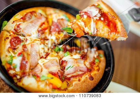 Hot Cannibal Slice Of Pizza With Extra Bacon, Ham And Vegetables