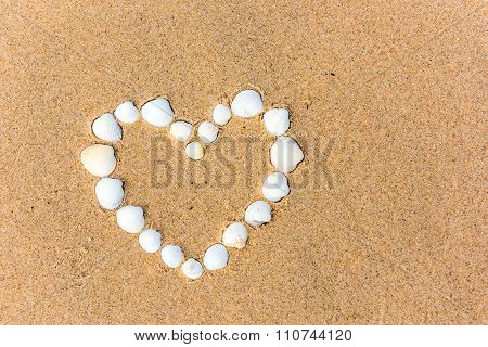 Sea Shell Heart On The Sand Beach