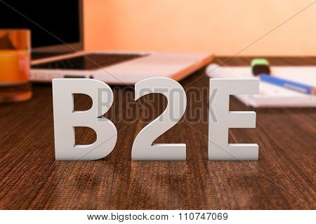 B2E - Business to Employee - letters on wooden desk with laptop computer and a notebook. 3d render illustration. poster
