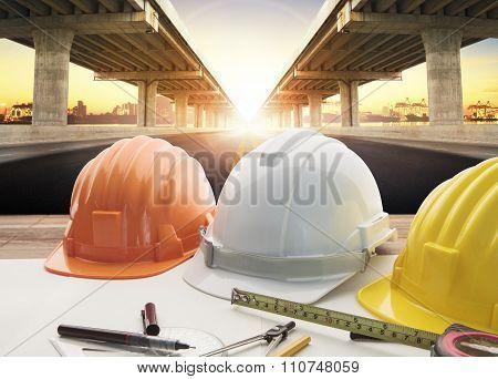 safety helmet on engineer working table