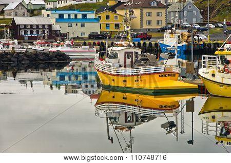 STYKKISHOLMUR, ICELAND - SEPTEMBER 4, 2015: Stykkisholmur harbor in west Icelandic fjord with citysc
