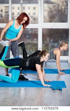 Kneeling Kickbacks Exercises With Instructor