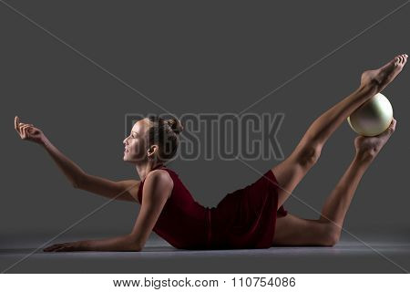 Gymnast Girl Doing Backbend Exercise With Ball