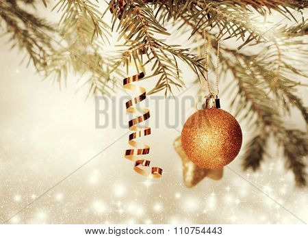 Christmas decorations and gift boxin front of snow cowered pine trees