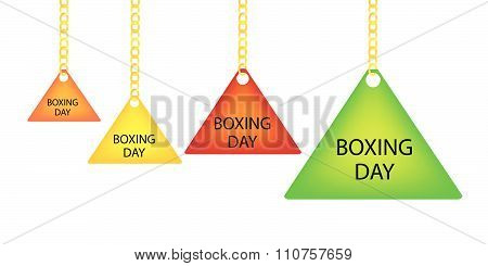 Boxing Day Triangle Label Holding On A Goldenl Chain