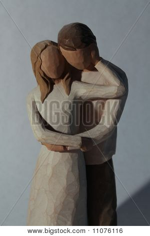 A Couples Statue In A Loving Embrace