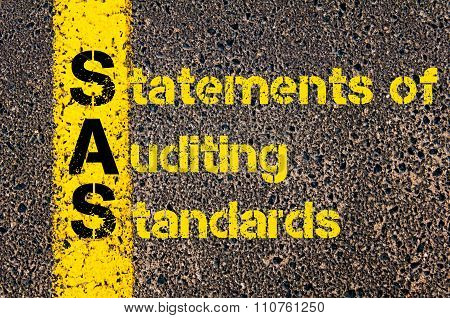 Concept image of Accounting Business Acronym SAS Statements of Auditing Standards written over road marking yellow paint line. poster