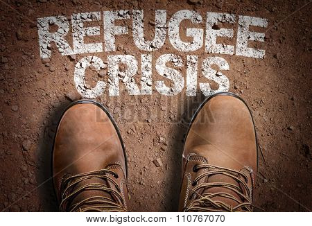 Top View of Boot on the trail with the text: Refugee Crisis