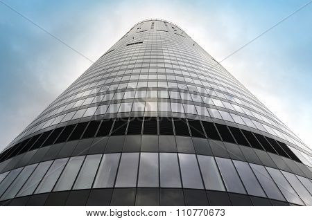 Looking up at a skyscraper