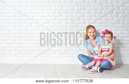 Concept Happy Family Mother And Baby Daughter,  Girl At Blank Brick Wall